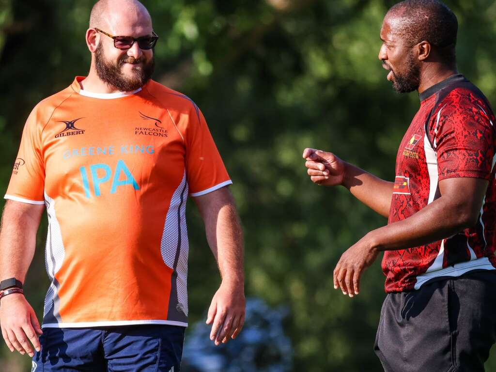The Gentlemen of Aspen Rugby Club's Jeff Barnhill, left, chats with Simon Dogbe during practice on Thursday, July 15, 2021, at Rio Grande Park in Aspen. Photo by Austin Colbert/The Aspen Times.