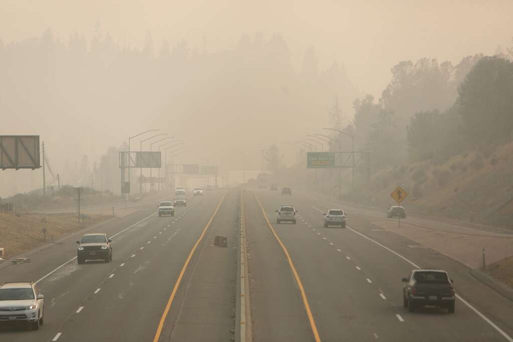 Vehicle traffic along the Golden Center Freeway can be seen driving into a shroud of smoke Saturday Sept. 13 between Grass Valley and Nevada City. | Photo: Elias Funez