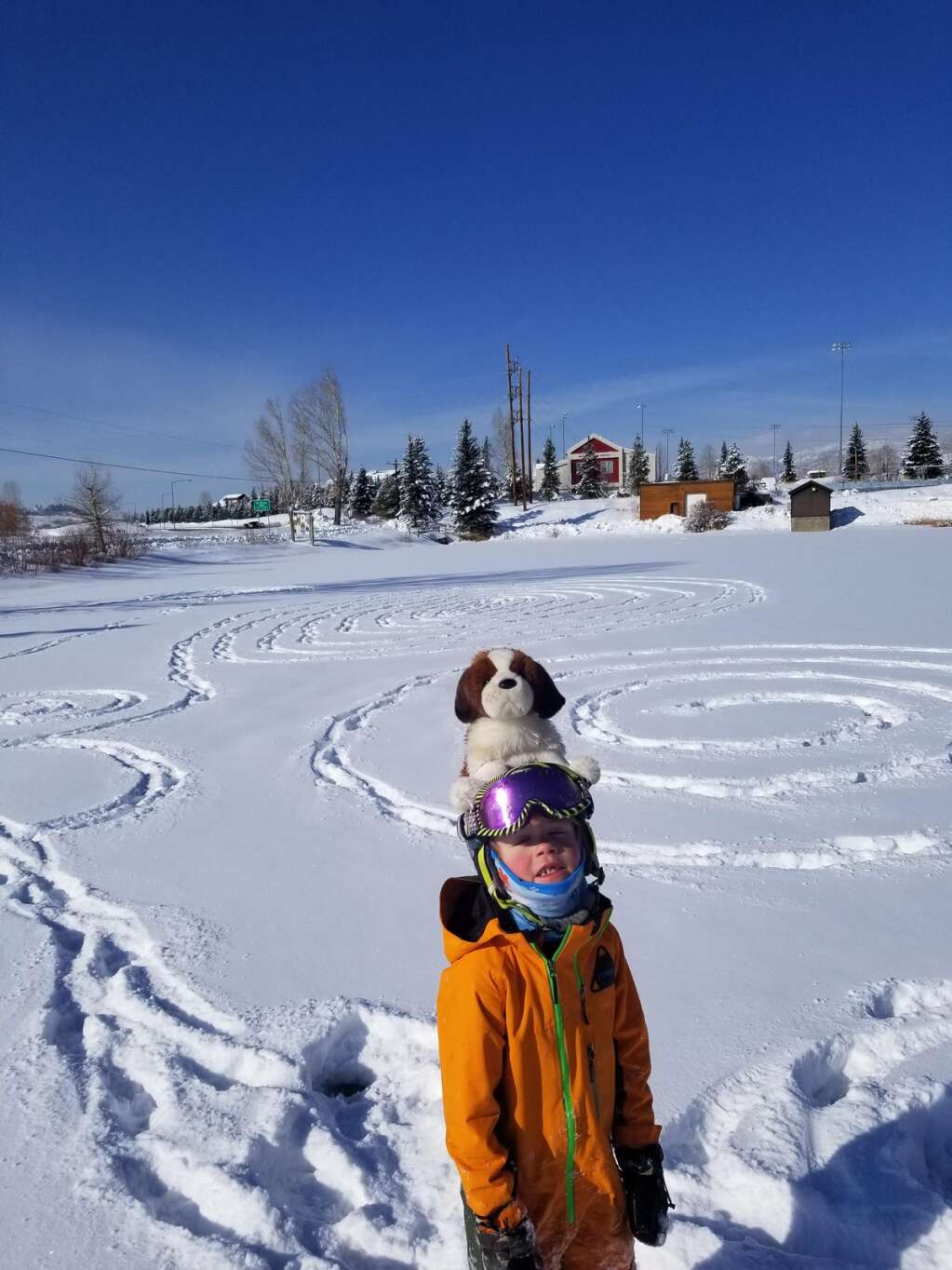 Isaac Reynolds, 6, and his Powder Dog made a Valentine's Day snow drawing on Casey's Pond.