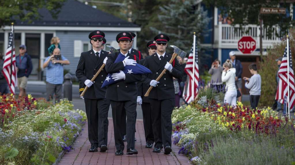The Park City Fire District Honor Guard presents the American flag in front of the Miners Hospital in City Park on Saturday morning as part of a ceremony marking the 20th anniversary of the Sept. 11 terrorist attacks. (Tanzi Propst/Park Record)