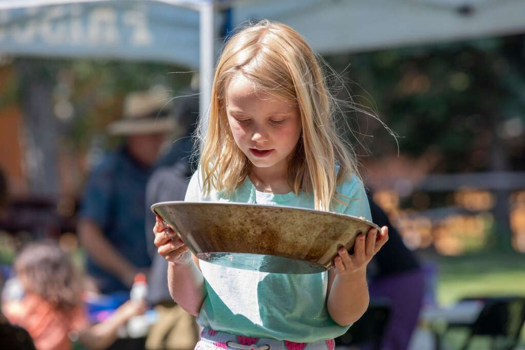 Jane Wyse searches for gold as part of Frisco History Day, Saturday July 10, 2021. The day included a picnic in the park, city tours, gold panning, games lawn, a baking contest and live music.  |  Photo by Ashley Low / Ashley Low Photography