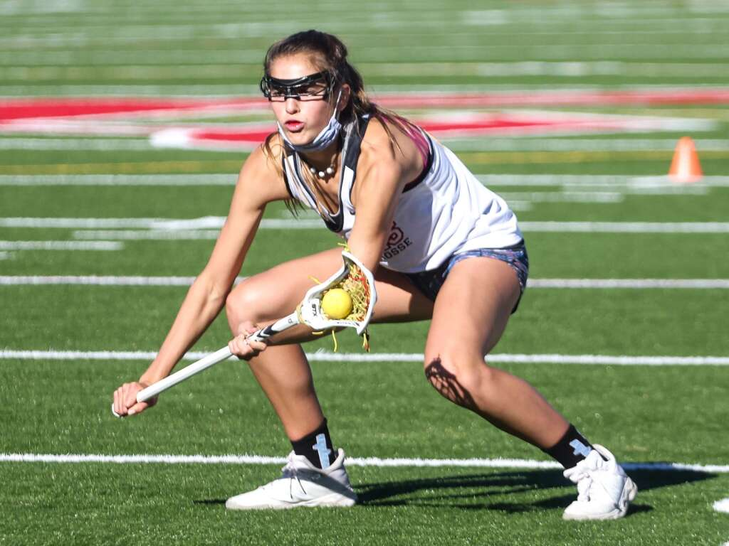 Aspen High School girls lacrosse senior Kylie Kenny fields a ball during team practice on Friday, April 30, 2021, on the AHS turf. Photo by Austin Colbert/The Aspen Times.