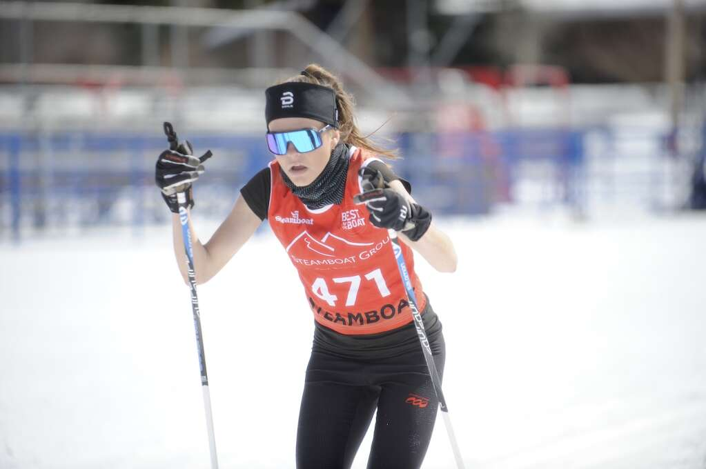 Caroline Baur crosses the finish line of the classic race at the state skimeister championships at Howelsen Hill on Tuesday, March 9.