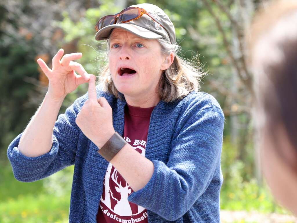 Aspen Camp of the Deaf and Hard of Hearing board member Christy Smith signs during an interview on the campus in Old Snowmass on Sunday, May 23, 2021. | Austin Colbert/The Snowmass Sun
