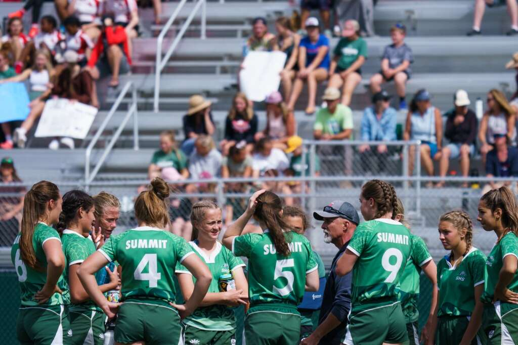 Summit Tigers head coach Karl Barth talks with is team at hal time during the Tigers' final match Saturday against against United of Utah during Summit's victory at their home Summit 7s tournament Saturday at Tiger Stadium in Breckenridge.   John Hanson/For the Summit Daily News