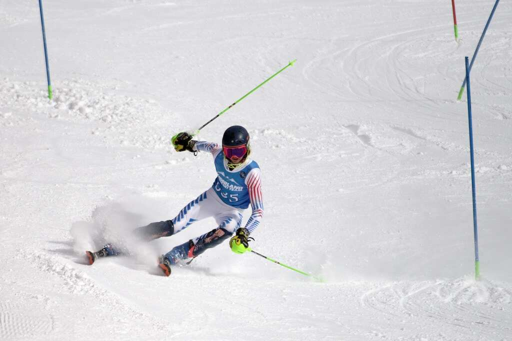 Nederland High School Alpine ski team racer Stanley Buzek loses control and skis off the slalom course during the Colorado High School State Alpine Ski Championships at Loveland Valley Ski Area on Thursday, March 11, 2021. | Photo by Jason Connolly / Jason Connolly Photography