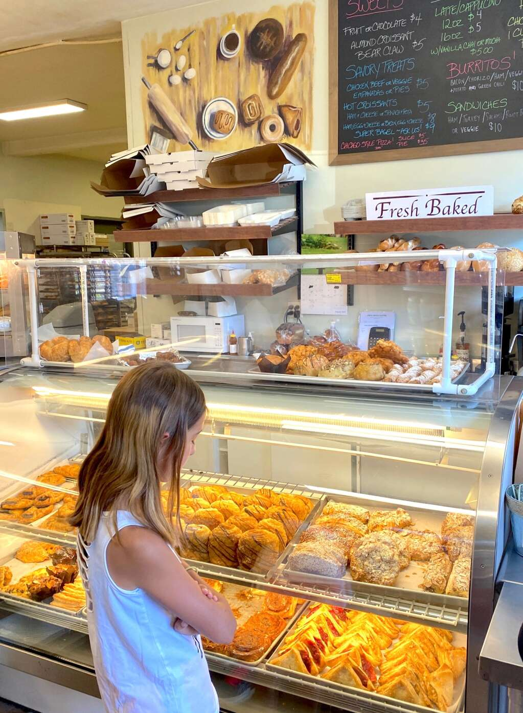 Decisions, decisions. A customer chooses a sweet treat at Louis Swiss Pastry on a recent morning.