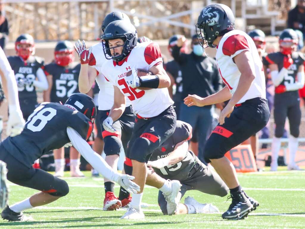 Steamboat Springs runner James Lahrman carries the ball against Aspen on Saturday, April 10, 2021, on the AHS turf. The Skiers won, 22-7. Photo by Austin Colbert/The Aspen Times.