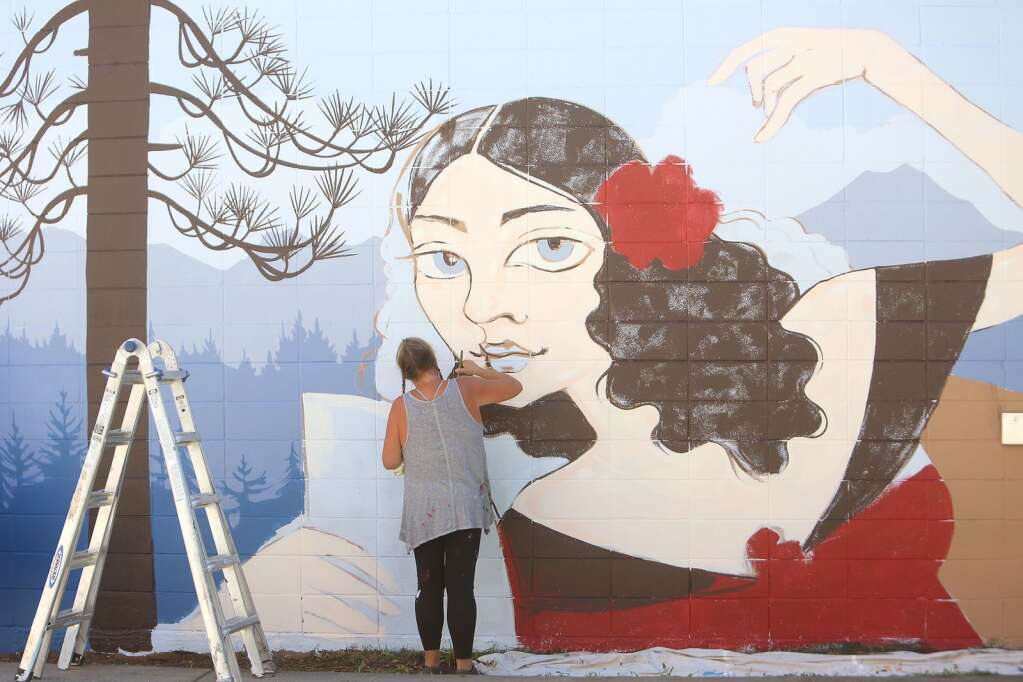 Downtown Grass Valley's latest mural takes shape alongside Sourdough and Co. at 121 Neal Street. Artist Ursula Young says that her mural depicting Lola Montez and a Sierra-scape with old Grass Valley buildings, is slated to be completed later that day Sept. 24. | Photo: Elias Funez
