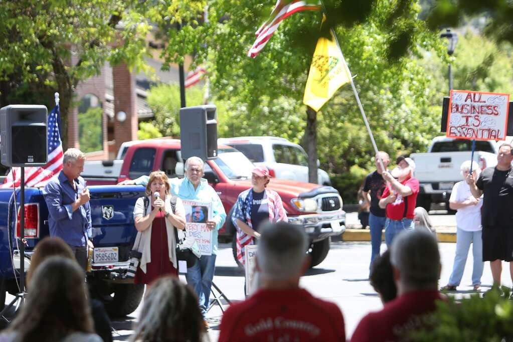 ReOpen Nevada County organizers and protesters gathered in downtown Grass Valley May 22 to promote the full reopening of the county. | Photo: Elias Funez