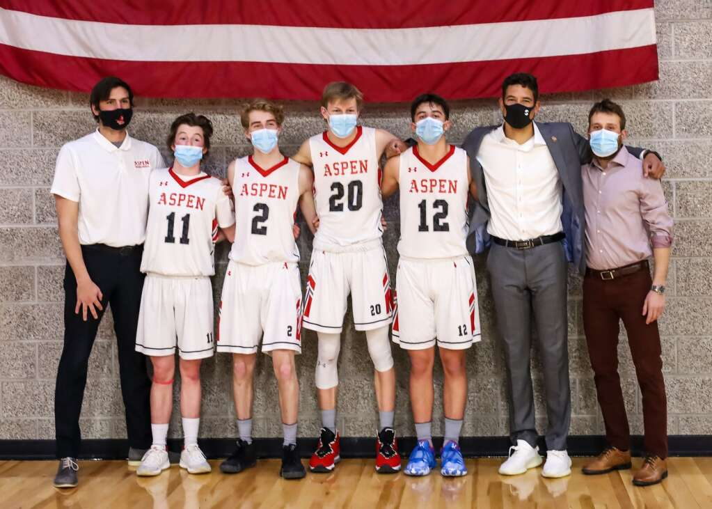 The Aspen High School boys basketball coaches and seniors pose after playing against Moffat County on Saturday, March 6, 2021, inside the AHS gymnasium. Aspen won, 68-42. Photo by Austin Colbert/The Aspen Times.