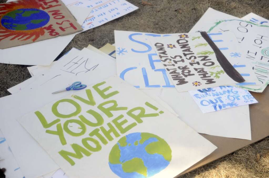 A pile of signs gather on the ground at a Climate Action Rally at the Routt County Courthouse Lawn on Friday afternoon. (Photo By Shelby Reardon)