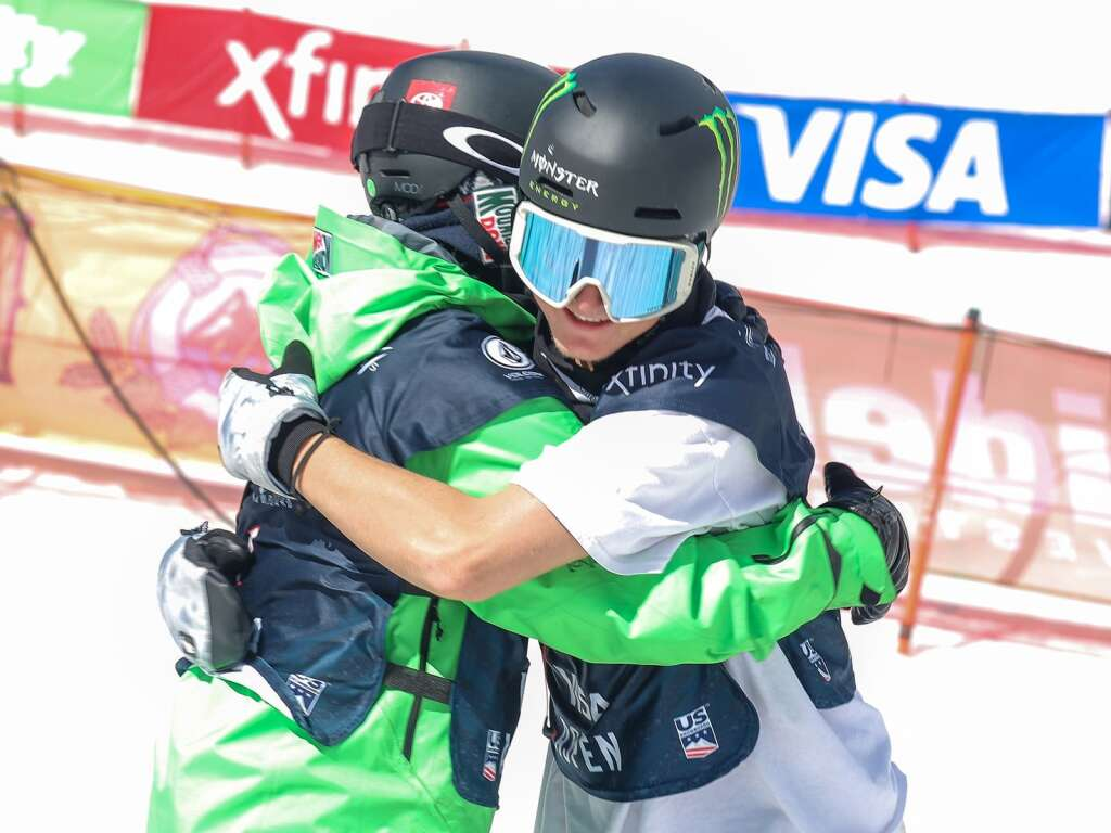Summit County's Red Gerard, left, hugs California's Dusty Henricksen during the men's snowboard slopestyle finals at the U.S. Grand Prix and World Cup on Saturday, March 20, 2021, at Buttermilk Ski Area in Aspen. Photo by Austin Colbert/The Aspen Times.