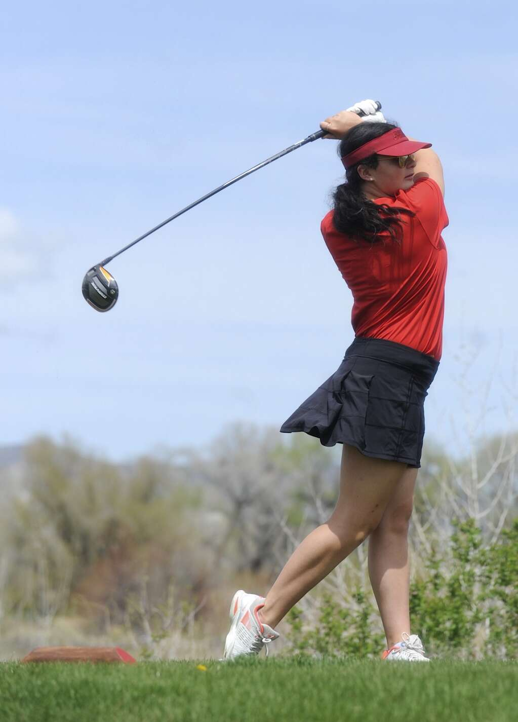 Steamboat Springs golfer Jacey Larock follows through her tee shot at the Bulldog Invite in Craig on Tuesday afternoon. (Photo by Shelby Reardon)