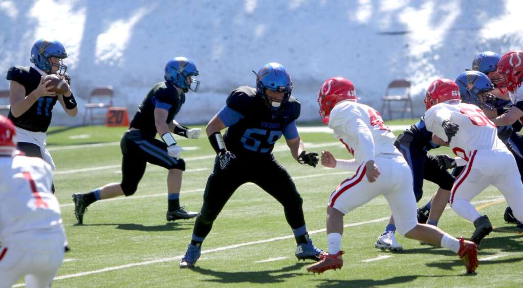 Senior offensive tackle JD Martinez protects against the pass rush Saturday against Wooster. <em id=