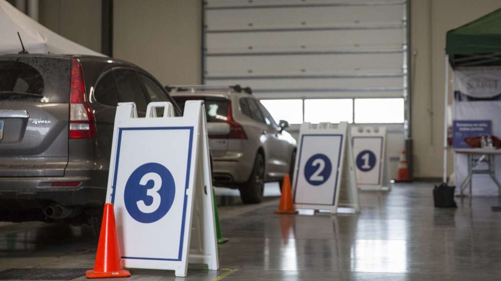 Patients park their cars in designated spots at the Utah Film Studios while waiting to receive their vaccinations Friday afternoon, Jan. 22, 2021. (Tanzi Propst/Park Record)