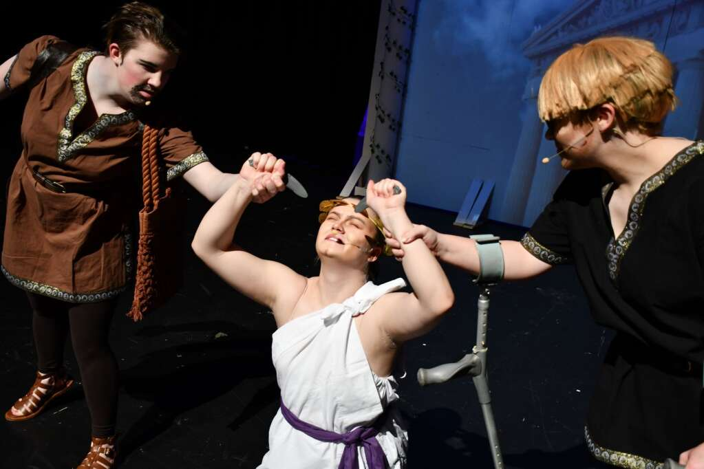 Peon (Nevaeh Allen), left, and Dialysis (Jessica Womble), right, stop Oedipus (Alyssa Rodriguez) from doing something drastic in
