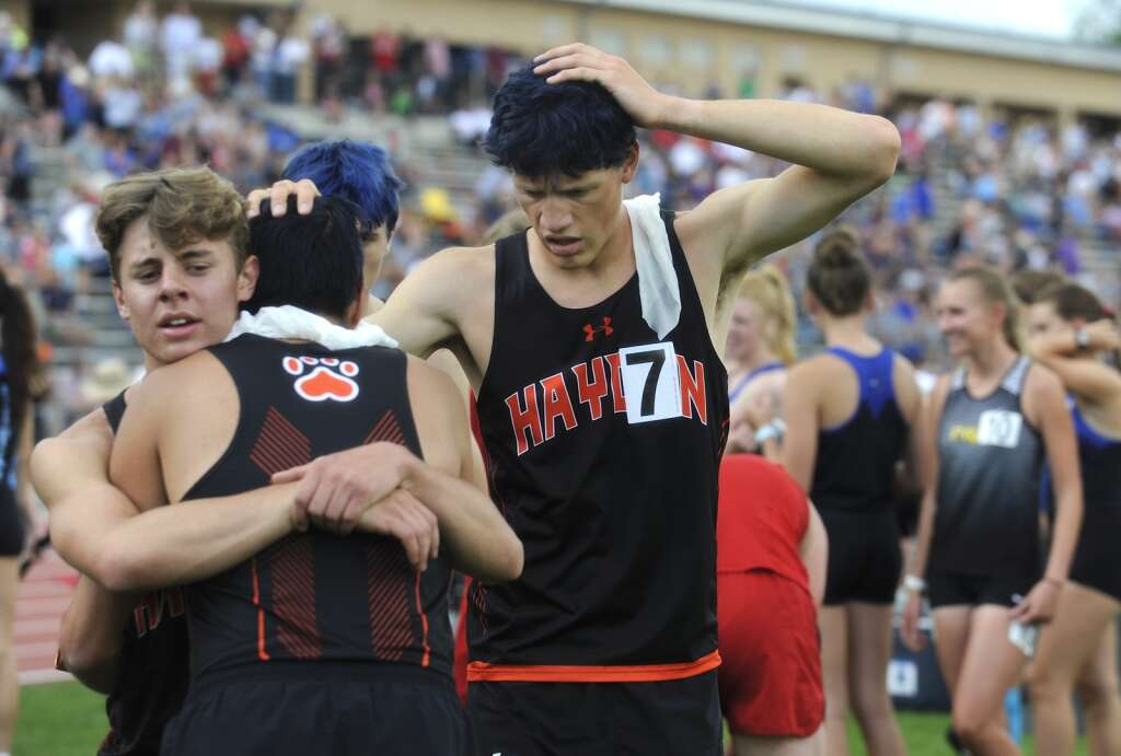 From left, Hayden sophomore Brayden Dale hugs senior Keaton Knez, as senior Andrew Kleckler pats his teammate on the back at the CHSAA Track and Field State Championships at JeffCo Stadium on Thursday. The Hayden 4x800 team, which also included Kale Johnson, took fourth. (Photo by Shelby Reardon)