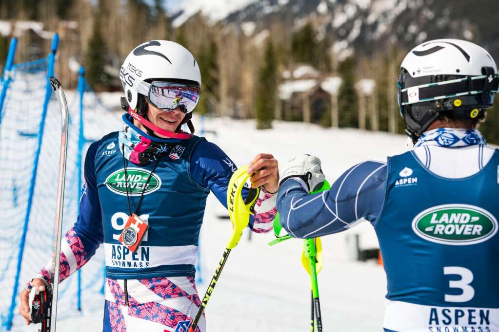 United States alpine skiers Garret Driller, left, and Erik Arvidsson congratulate each other after placing in the U.S. Alpine Men's Slalom Championships at Aspen Highlands on Monday, April 5, 2021. Arvidsson placed second and Driller placed third behind teammate Benjamin Ritchie. (Kelsey Brunner/The Aspen Times)