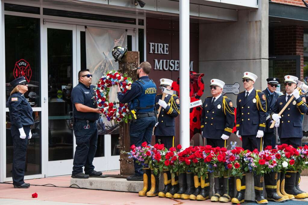 A wreath and helmet are added to the 9/11 memorial outside of the Aspen Fire Department on East Hopkins during the 20th annual Day of Remembrance for 9/11 at Aspen Volunteer Fire Department on East Hopkins on Saturday, Sept. 11, 2021. (Kelsey Brunner/The Aspen Times)