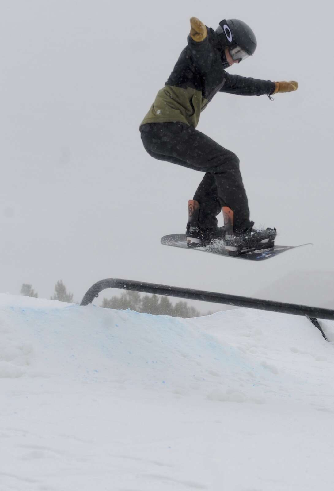 Johnny Duty flies through the air at a free, public rail jam at Howelsen Hill on Saturday.