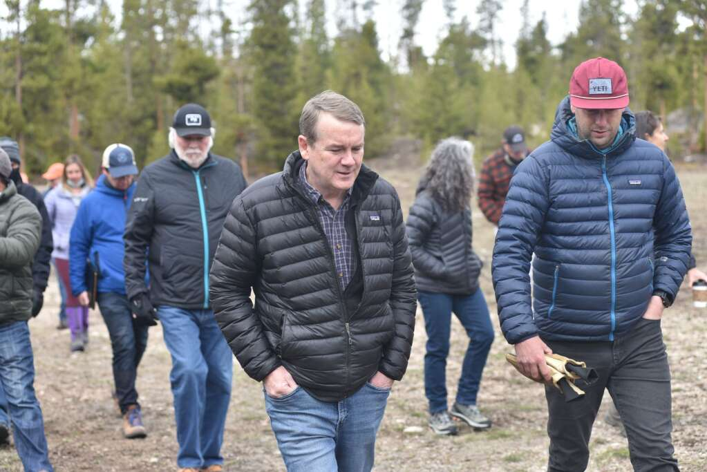 Colorado Sen. Michael Bennet speaks with Grand Lake property owner Bill Mueller about the 2020 historic fire season and Mueller's participation in the Emergency Watershed Protection program. | McKenna Harford/mharford@skyhinews.com