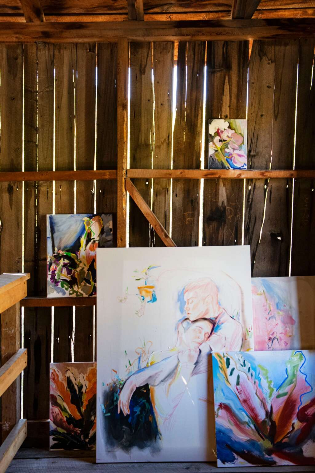 Paintings by Denver-based artist Kaitlyn Tucek leans against the wall of a building in the Ashcroft Ghost Town outside of Aspen as part of her two-day exhibition 'The Lilac Hour' outside of Aspen on Friday, Sept. 17, 2021. (Kelsey Brunner/The Aspen Times)