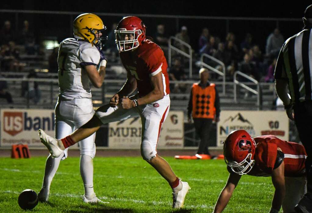 Glenwood Springs Demon Joaquin Sandoval reacts after running the ball into the endzone late in the first half during Friday night's game against the Basalt Longhorns.|Chelsea Self / Post Independent