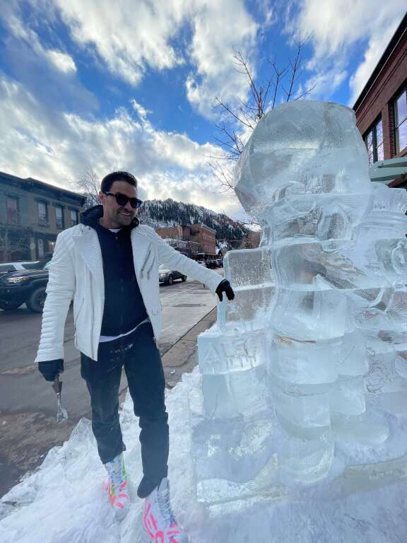 Alec Monopoly with his ice sculpture at Eden Gallery on Friday, Feb. 19. Courtesy Eden Gallery