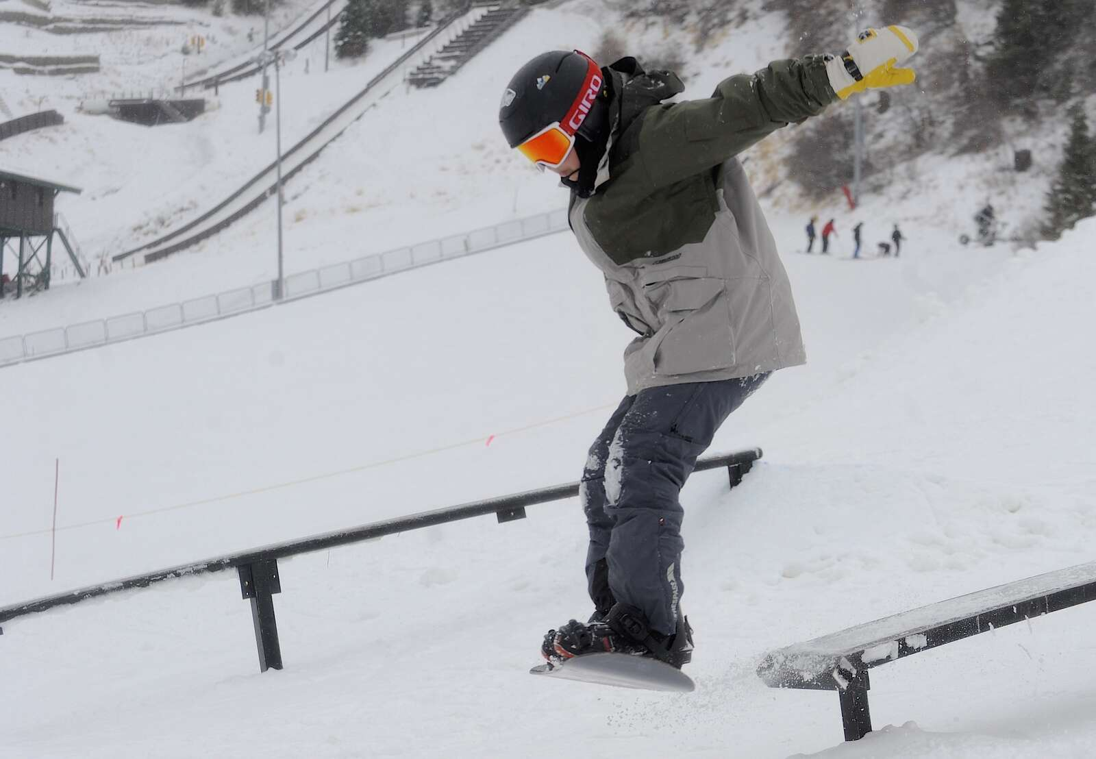 Ricky Hernandez spots is landing after riding a rail at a free, public rail jam at Howelsen Hill on Saturday.