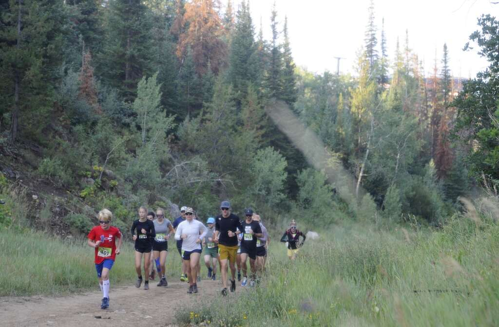 A group of 5-mile runners ascend Zig Zag on Steamboat Resort at the Continental Divide Trail Run on Saturday morning. (Photo by Shelby Reardon)