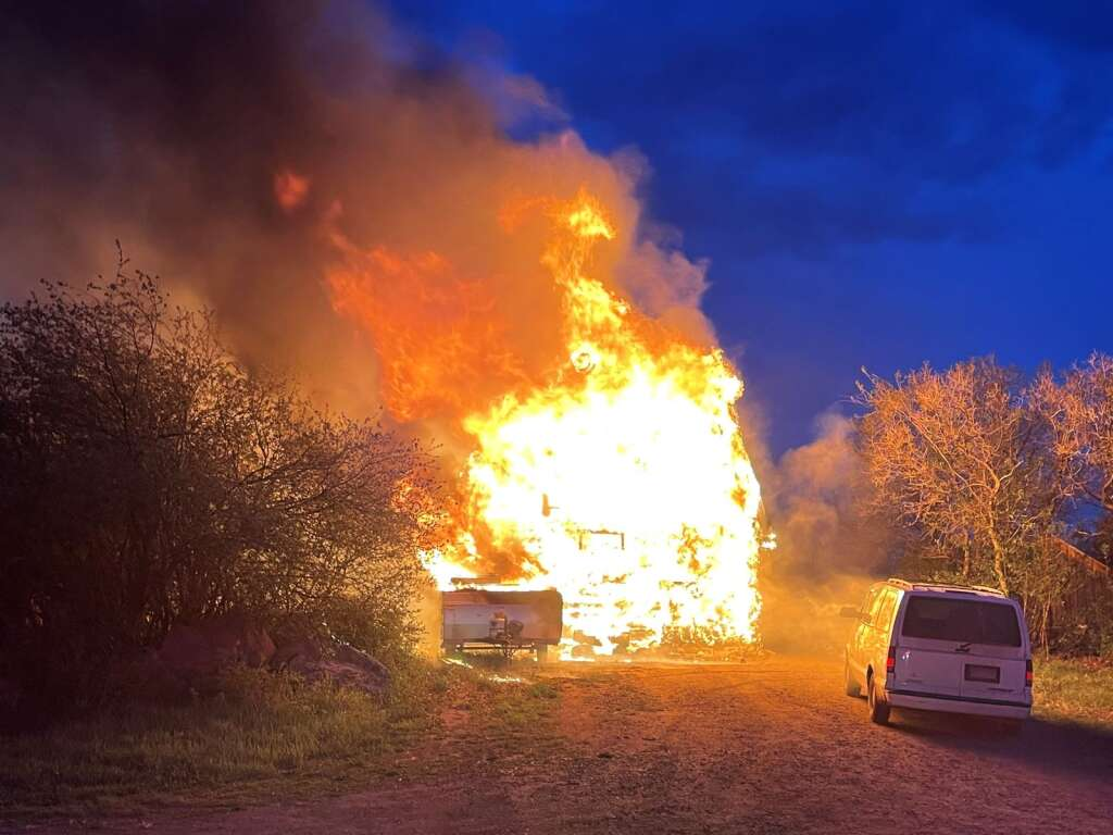 A house, travel trailer and vehicle were destroyed by a fire Wednesday night on the remote Buck Point Road. | Roaring Fork Fire Rescue/courtesy photo