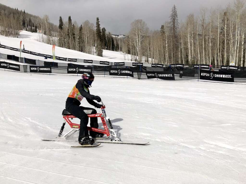 Snowbiker Anne Fields rides into the finish area after competing in the Bronze division slalom race at NASTAR national championships in Snowmass on April 6, 2021. | Kaya Williams/The Aspen Times