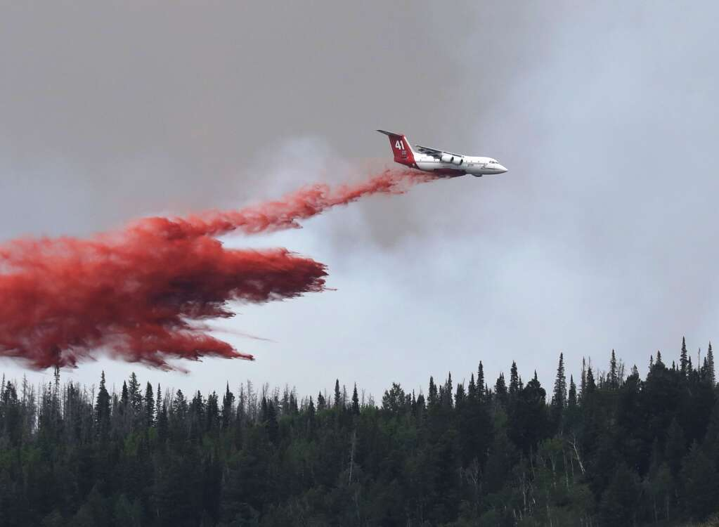 An airtanker drops a slurry on the Muddy Slide Fire Wednesday afternoon as crews continue to battle the blaze just east of Yampa with air power. This plane was seen making a run at the fire from Gore Pass. | John F. Russell/Steamboat Pilot & Today