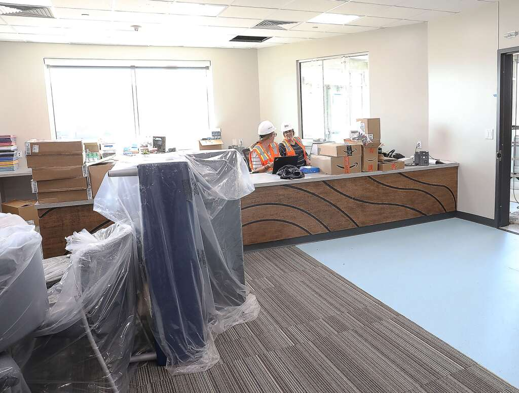 Office manager Andrea Kortas, right, and registrar Mary Grefrath  work in the new administrative offices at the Sleeping Giant School. (Photo by John F. Russell)