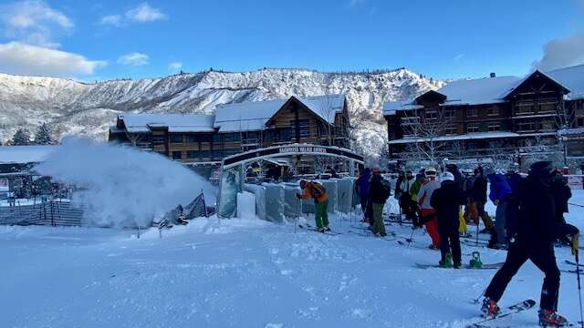 Before 8 a.m. Thursday a solid line started at the Village Express at Snowmass Resort as lifties worked to clear the corrals. The report of 20 inches at Snowmass from the overnight snowstorm brought out the crowds. (David Krause / The Aspen Times)