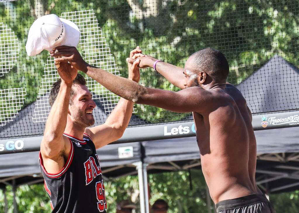 Eddie Moushikhian, left, and teammate Jeff Samuels celebrate after winning the men's open finals of the MotherLode Volleyball Classic on Monday, Sept. 6, 2021, at Koch Lumber Park in Aspen. Photo by Austin Colbert/The Aspen Times.