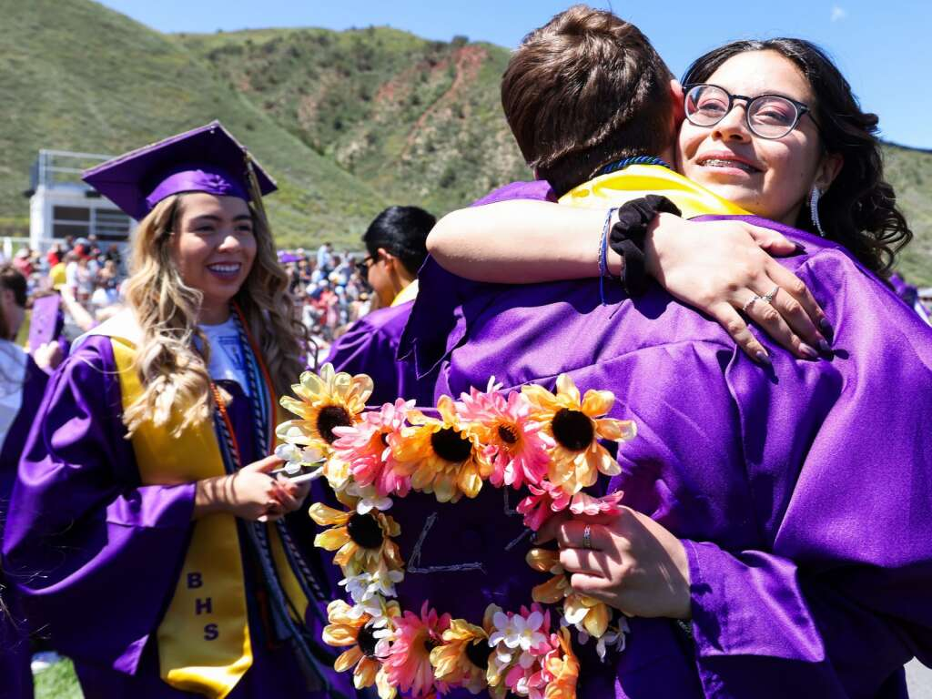Students hug in celebration following the Basalt High School graduation ceremony on Saturday, May 22, 2021, on the BHS football field. Photo by Austin Colbert/The Aspen Times.
