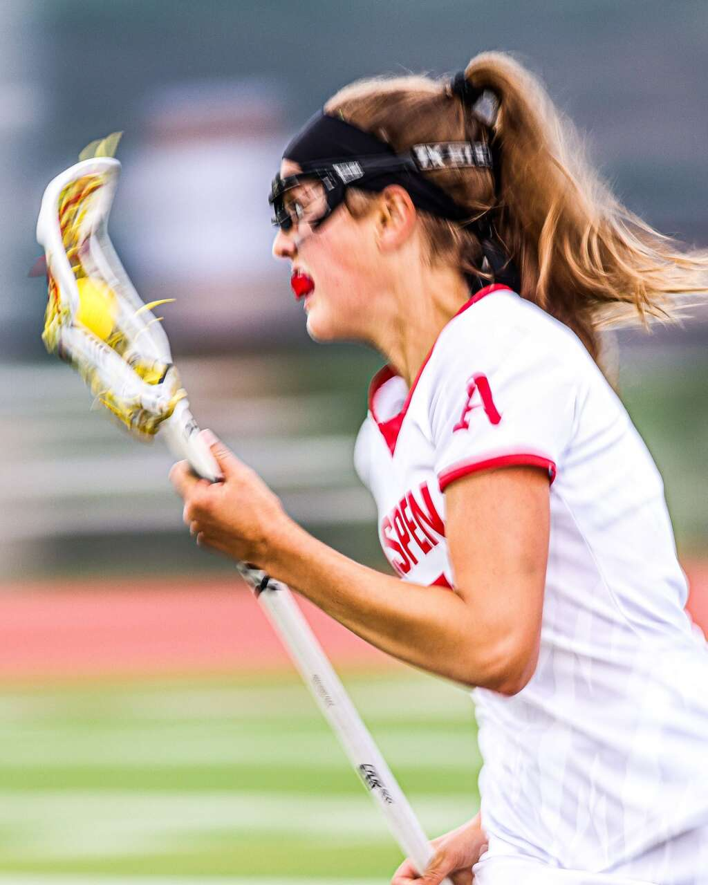 Aspen High School senior Kylie Kenny brings the ball upfield in the girls lacrosse game against Castle View in the Class 4A state quarterfinals on Saturday, June 19, 2021, on the AHS turf. The Sabercats won, 10-9. Photo by Austin Colbert/The Aspen Times.