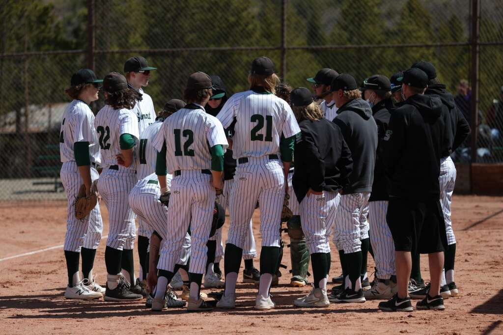The Summit High School varsity baseball team huddles in the season opener vs. Holy Family on May 8 at the Frisco Peninsula Recreation Area.   Photo by Ashley Low / Ashley Low Photography