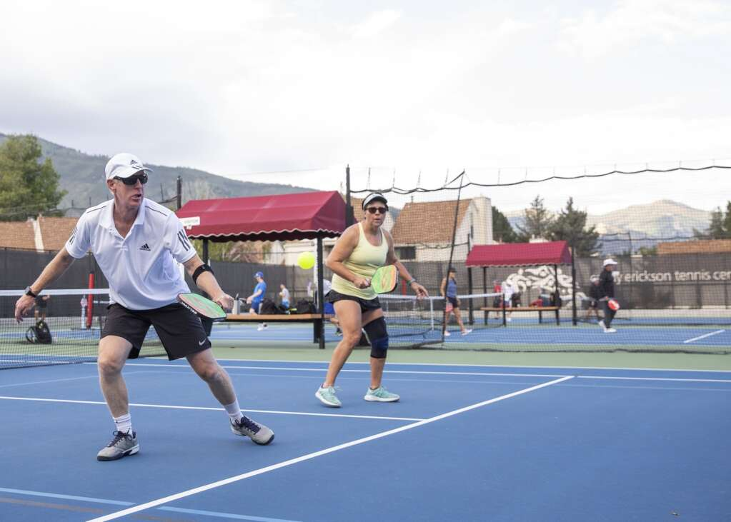 Paul Cassell returns a volley during a pickleball matchup at the PC MARC during the club's marathon event Saturday morning, Sept. 11, 2021. (Tanzi Propst/Park Record)