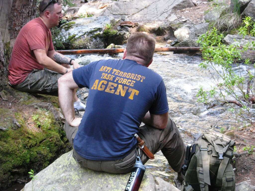 Two veterans chat during a break on a hike into wilderness surrounding Aspen. | Huts for Vets/courtesy photo
