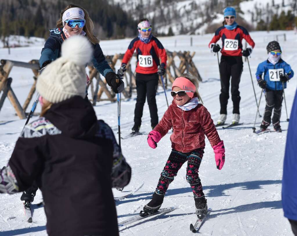 A young skier completes the kid's 2K fun race at the Stampede on Saturday at Snow Mountain Ranch. | Amy Golden / agolden@skyhinews.com