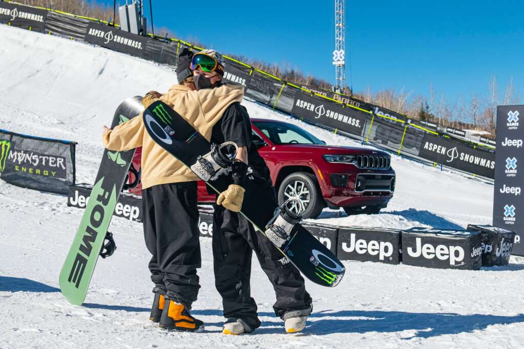 Snowboarders Rene Rinnekangas, left, and Dusty Henricksen hug as they take their perspective podiums after medaling in the X Games 2021 men's snowboard slopestyle finals at Buttermilk on Sunday, Jan. 31, 2021. (Kelsey Brunner/The Aspen Times)