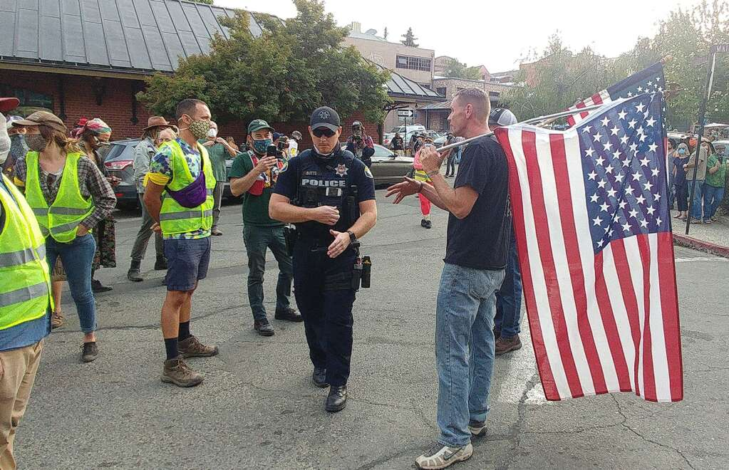 Nevada City Police officers were on hand to diffuse any potential altercations between peaceful protesters and potential counter protesters Sept. 28 at the Black lives lost vigil in Nevada City. | Photo: Elias Funez