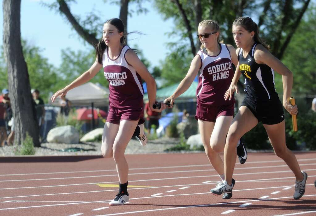 Soroco's Larhae Whaley passes the baton to Marissa Martindale during the 4x100 prelims at the CHSAA Track and Field State Championships at JeffCo Stadium on Friday. (Photo by Shelby Reardon)