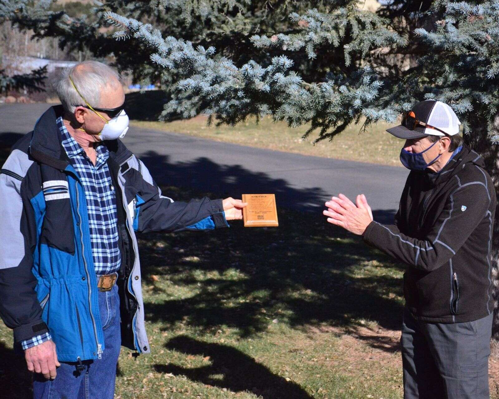 Kevin O'Brien (left) receives recognition for his co-founding role with Roaring Fork Outdoor Volunteers at a ceremony in Basalt on Dec. 5.| Courtesy photo