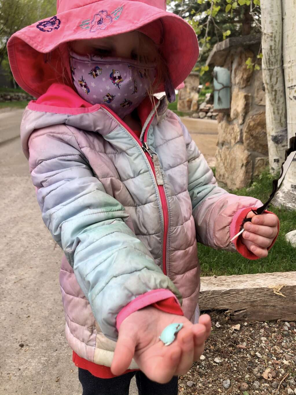 Evelyn Ferguson, age 4, shows off a robin's egg shell she spotted during the annual Snowmass Village Town Clean Up Day on Friday, May 21, 2021. (Kaya Williams/The Snowmass Sun)