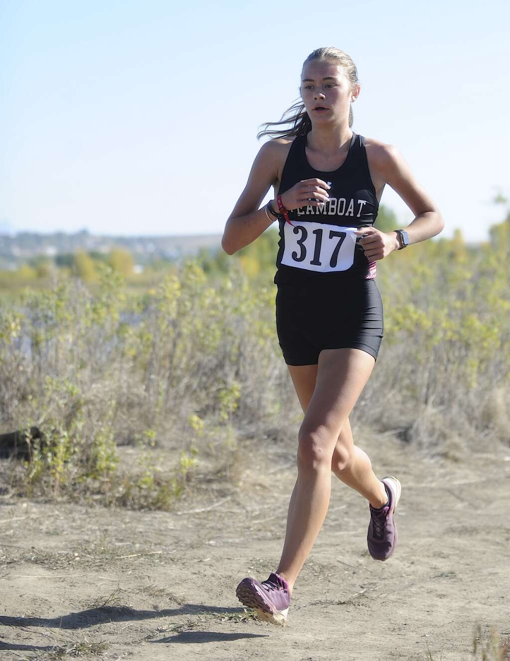 Steamboat Springs senior runner Kelsey Hamilton finds her stride at a cross country meet at Loudy-Simpson Park in Craig on Saturday morning.   Shelby Reardon/Steamboat Pilot & Today