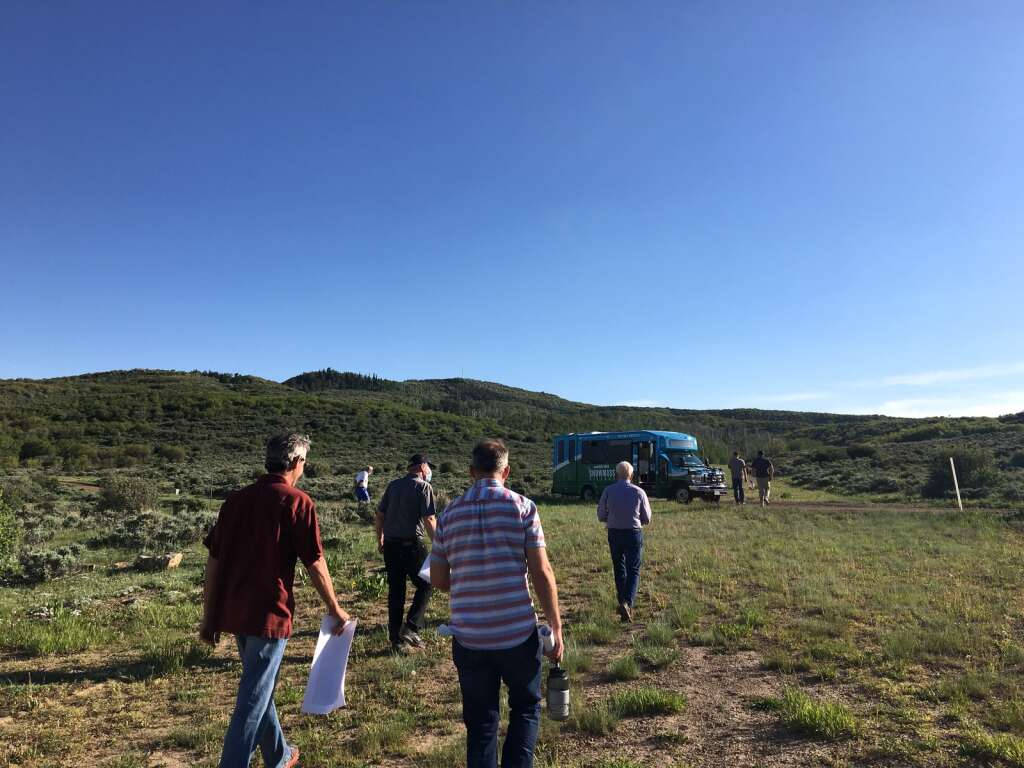 Snowmass Village Town Council members and town staff walk toward a special service Village Shuttle bus during a site visit at Cougar Canyon on Monday, June 7, 2021.   Kaya Williams/The Snowmass Sun
